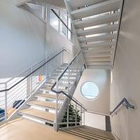 Guardrail mounted handrail