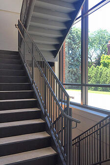 Metal stair with poured concrete treads